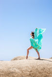 Girl dancing in the wind Stock Images