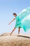 Girl dancing in the wind. With a cloth Royalty Free Stock Photo