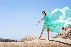 Girl dancing in the wind. With a cloth Stock Photo