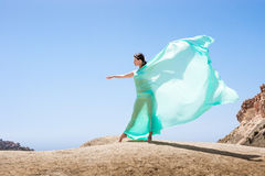 Girl dancing in the wind. With a cloth Stock Images