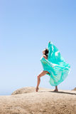 Girl dancing in the wind. With a cloth stock photography