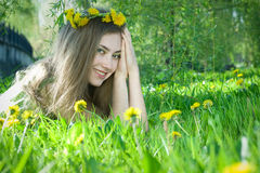 Girl with dandelion Stock Photography