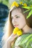Girl with dandelion Stock Photo