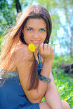 Girl with dandelion. In the park Stock Image