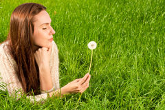 Girl with dandelion. On the green field Stock Image