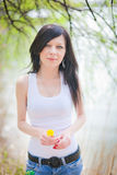 Girl on dandelion Royalty Free Stock Image