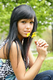 Girl with dandelion. Picture of young girl with dandelion in the park Royalty Free Stock Image