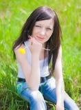 Girl on dandelion Stock Image