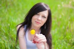 Girl on dandelion Royalty Free Stock Photos