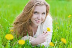 Girl on dandelion Royalty Free Stock Photo