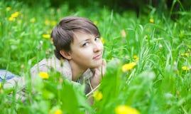 Girl on dandelion Royalty Free Stock Photography
