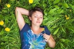 Girl on dandelion Stock Photography