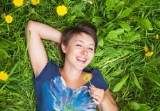 Girl on dandelion Royalty Free Stock Images