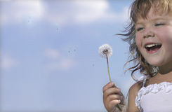 Girl with dandelion. On blue sky Stock Images