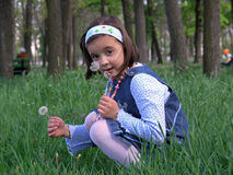 Girl with Dandelion. In hands Stock Photo