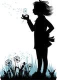 Girl with the dandelion Stock Photos