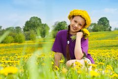 Girl with dandelion bouquet and wreath Stock Images