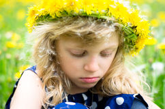 Girl with dandelion chain Royalty Free Stock Images