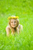 Girl in dandelion chaplet Stock Images