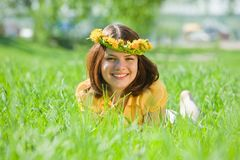 Girl in dandelion  chaplet Royalty Free Stock Photo