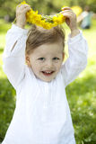 Girl with dandelion diadem on beautiful meadow stock photo