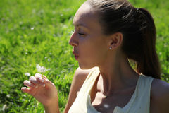 Girl with a dandelion Stock Image