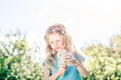 Girl with dandelion flower. Beautiful girl with white dandelion flower Royalty Free Stock Photos