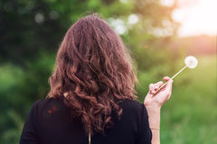 Girl with a dandelion in the hand Royalty Free Stock Photos