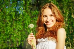 Girl with a dandelion in his hand Stock Photos