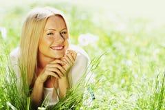 Girl with a dandelion Stock Photos