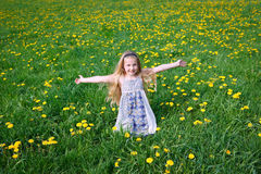 Girl on dandelion meadow Royalty Free Stock Image