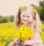 girl with dandelion outdoor Stock Photos