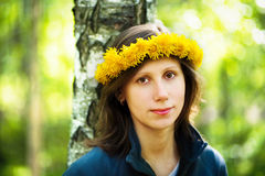 Girl with dandelion's wreath Royalty Free Stock Image