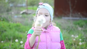 Girl with dandelion- video stock footage
