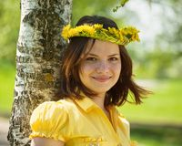 Girl in  dandelion wreath. Brunette teen girl in  dandelion wreath  near birch Royalty Free Stock Photos