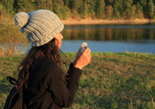 Girl with dandelion Stock Photography