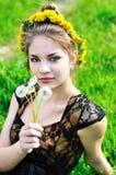Girl with dandelions Stock Image