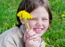 Girl with dandelions. Royalty Free Stock Images