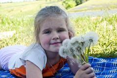 The girl with dandelions Stock Images