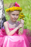 Girl and dandelions Royalty Free Stock Photo
