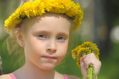 Girl and dandelions Stock Photo