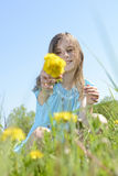 Girl with dandelions Stock Photos