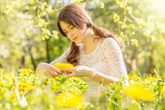 Girl with dandelions Stock Photos