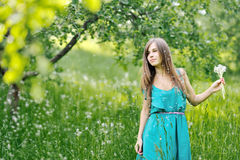 Girl with a dandelions outdoors Stock Photography