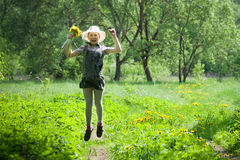Girl with dandelions up air Royalty Free Stock Photo