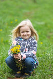 Girl with dandelions Stock Photo