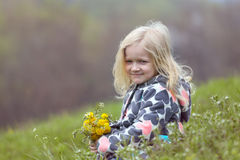 Girl with dandelions Stock Images