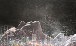 Girl on dark background. Mixed media. Profile of kid girl on grunge cityscape background. Mixed media Stock Photography