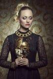 Girl with dark baroque mask Stock Photos