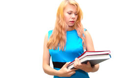 Girl in a dark blue dress and books. Portrait of the young girl in a dark blue dress with books in hands Royalty Free Stock Photos